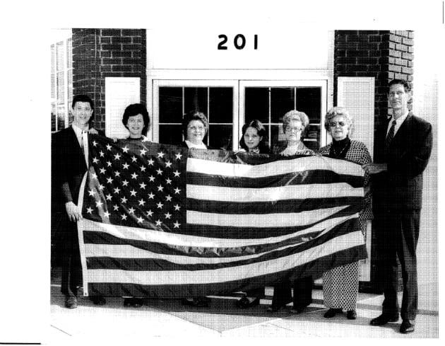 V. W. GOULD II & Staff IN 1973 HOLDING AMERICAN FLAG