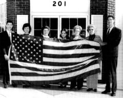 V. W. GOULD II & STAFF IN 1973 HOLDING AMERICAN FLAG